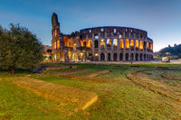 The illuminated Colosseum in Rome before sunrise