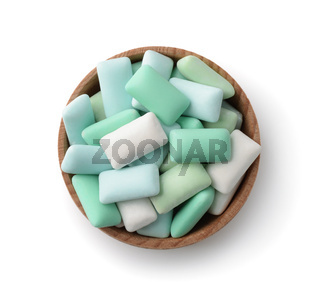Top view of wooden bowl with mint chewing gum