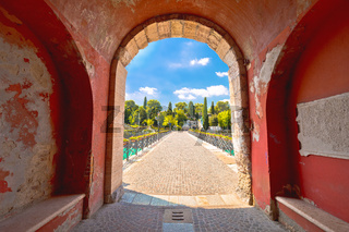 Peschiera del Garda colorful Italian town bridge and city walls entrance view