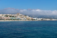 Panorama view on the city of Altea along Costa Blanca coast with cloudy mountainrange, Spain