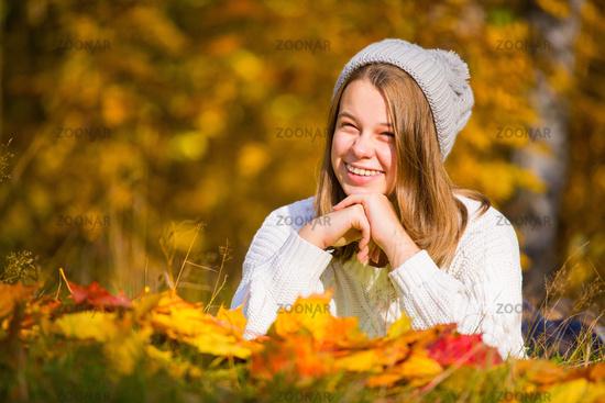 Pretty girl in autumn park