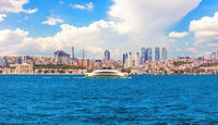 The Bosphorus straight view, the Dolmabahce palace and Besiktas skyscrappers in the background, Istanbuil, Turkey
