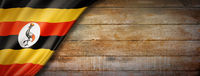 Uganda flag on vintage wood wall banner