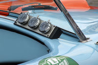 3 stopwatches on a dashboard of a historic car