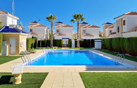 Torrevieja, Spain - November 4, 2019: Modern apartments with public swimming pool beautifully decorated leisure area cozy place for sunbath, real estate purchasing, loan mortgage, new dwelling concept