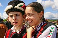 Happy teenager boy and a girl in festive clothes