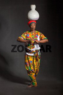 African man in traditional clothes toothy smile, on gray background