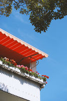 balcony in germany with geranium flower boxes and marquee