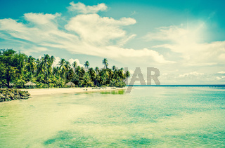 Tropical beach resort at turquoise ocean