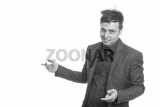 Studio shot of crazy Caucasian businessman showing something