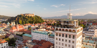 Cityscape of Ljubljana, capital of Slovenia, and it's old skyscraper in warm afternoon sun.