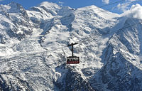 Cabin of the Brevent cable car aigainst the Mont Blanc massif, Chamonix, Haute-Savoie, France