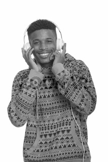 Young happy African man listening to music