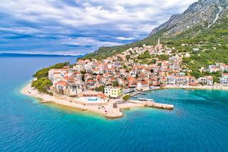 Igrane village on Makarska riviera and Biokovo mountain aerial view
