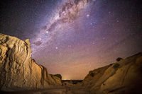 Night skies over desert landscape