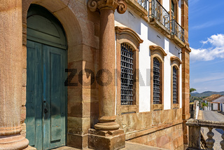 Facade of a historic building and its columns, doors and windows in baroque architecture
