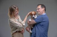 Happy family in studio with pet