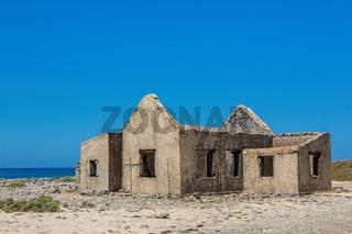 Old historic house as ruin on beach