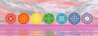 Seven chakra symbols on the horizon line - 3D render