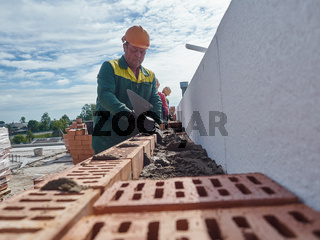 Vitebsk-Republic of Belarus. May 27 2019: Vitebsk construction company carries out work on the construction of brick houses in the city, as well as works on the creation of a new highway.Editorial.