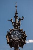 Bronze composition with the clock set at the beginning of Bauman street in Kazan
