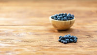 Brown bowl with blueberries on table with copy space