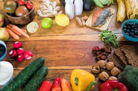 fresh fruits and vegetables on a wooden table
