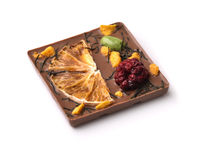 Craft chocolate bar with dry orange and blackberry