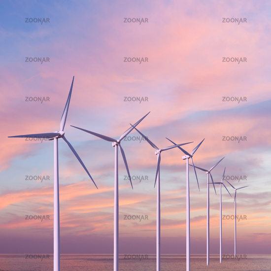 Wind generators turbines in the sea on sunset