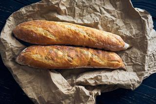 Homemade baguette bread on dark wooden table