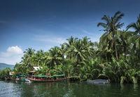 traditional jungle boat at pier on tatai river in cambodia