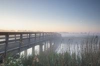 serene sunrise over bridge and river