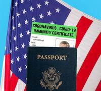 US passport with virus immunity certificate against USA flag