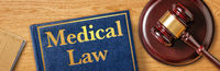 A gavel with a law book - Medical Law