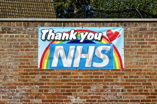 A Thank You NHS banner attached to a brick wall