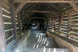 SIGHISOARA, TRANSYLVANIA/ROMANIA - SEPTEMBER 17 : Wooden tunnel down from the Church on the Hill in Sighisoara Transylvania Romania on September 17, 2018. Unidentified people