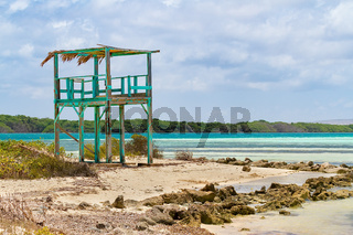 Lookout tower on beach next to the sea