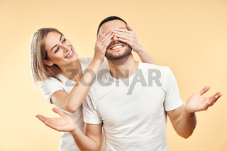 Guess who. young woman covering eyes of her boyfriend