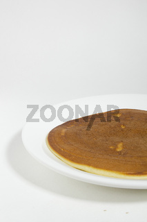 Freshly baked pancake on a plate