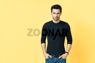Handsome confident man on yellow background