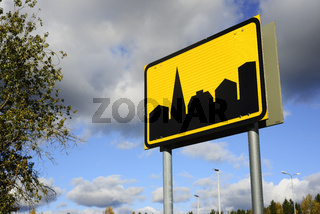 road sign settlement on the sky background