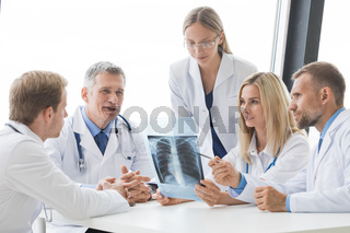Team of expert doctors with x-ray