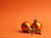 Orange vintage Christmas baubles on an orange background
