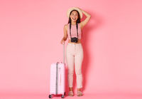 Tourism, summer vacation, holidays abroad concept. Full length of carefree pretty asian girl in summer clothes, straw hat and camera, close eyes and smiling on tour, standing with suitcase