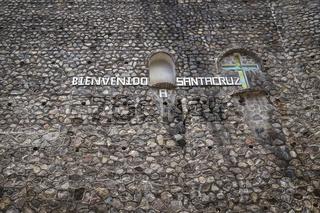 Letters on natural stone wall at the entry of village saying 'Welcome to Santa Cruz' at Santa Cruz La Laguna, Guatemala