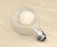 Decorative LED bulb on wood