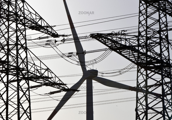 Two overhead line pylons and a wind turbine, Witten,  North Rhine-Westphalia, Germany, Europe