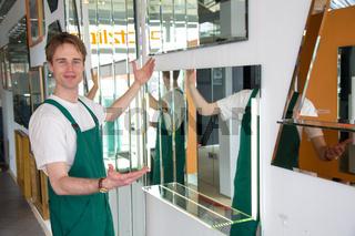 Glazier craftsman presenting mirrors