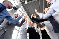 business people making high five at office