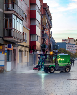 Watering machine cleaning cityscape Barcelona